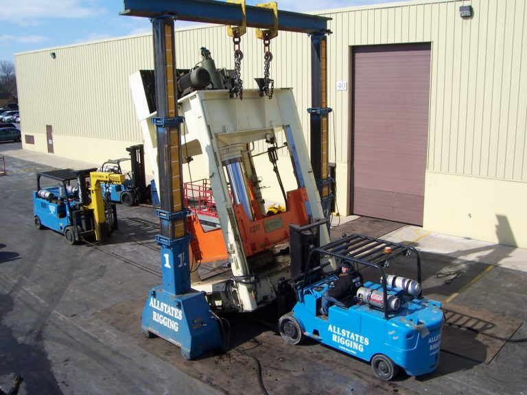 Allstates Rigging forklifts moving a big machine