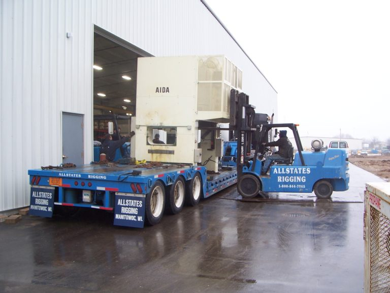 Allstates Rigging transporting an Aida machine