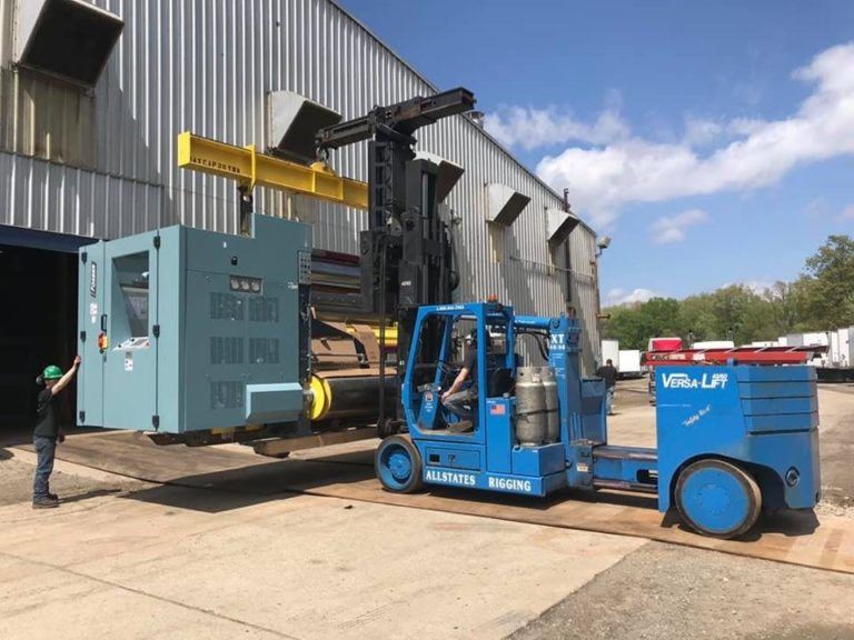Forklift lifting a millwright machine
